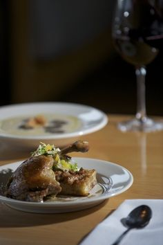 Roots Restaurant's crispy duck confit with cranberry pear bread pudding and cauliflower soup with truffle oil and sunchoke chips. pear bread, chip, truffl oil, cranberri pear