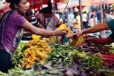 Fruit and Vegetables Stall in Quiapo Market, Manila. Pumpkins, squash flowers, water spinach and other vegetables are rich in vitamins (including pro-vitamin A) and minerals. These vegetables are widely available in local markets of the Philippines or can be grown in backyards and communal gardens.