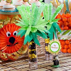 Aww-some DIY rock candy palm trees for a jungle-y baby shower candy buffet. Guests will go (coco) nuts for 'em!