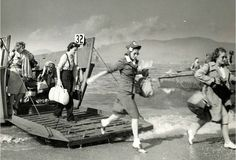 Here's a Normandy Beach landing photo they don't show you in textbooks. Brave women of the Red Cross arriving in 1944 to help the injured troops. Bad ass.