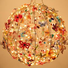 This gorgeous light can brighten up any space with its colors, sparkle and very ethereal beauty. It can bring the garden into the house or bring rainbow into the garden. Love it!