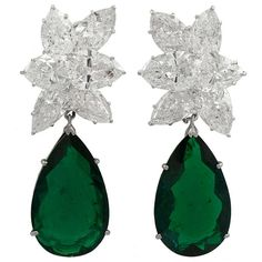 Harry Winston Emerald Diamond Earrings | From a unique collection of vintage dangle earrings at http://www.1stdibs.com/jewelry/earrings/dangle-earrings/