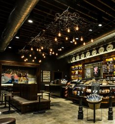 For the New Orleans Starbucks Store on Canal Street, local sculptor David Borgerding built chandeliers from old wrought iron gates to honor the city's mercantile roots. starbuck store, starbucks store