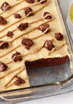 Peanut Butter Poke Cake Brownies -- Brownies get the poke-cake treatment in this scrumptious dessert recipe--and are filled with a creamy mixture of peanut butter and vanilla pudding.