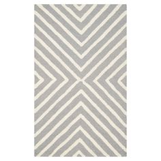 Infusing your decor with bold geometric style, this hand-tufted wool rug showcases a graphic arrows motif.     Product: Rug