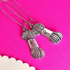 $7.00.  Yarn earrings.  Love these.  So perfect.  :)