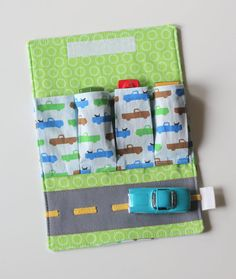 Made something like this with Cars fabric.    Toy Car Wallet with Road  Includes 4 Cars by threeloves on Etsy, $20.00