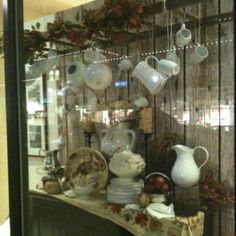From a window display at Pottery Barn in Jacksonville, FL.   A ladder used as a trellis over a buffet. Beautiful!!!!