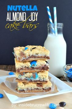 Nutella Almond Joy Cake Bars from insidebrucrewlife.com - cake mix bars filled with Nutella, coconut, and Almond Joy pieces
