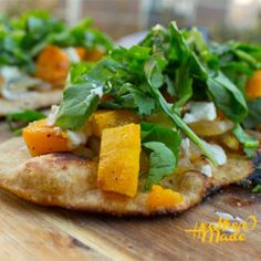 Roasted Butternut Squash & Caramelized Onion Flatbread with Goat Cheese & Greens #Recipe