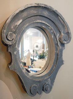 Zinc oeil-de-Boeuf window off a chateau converted to a mirror.