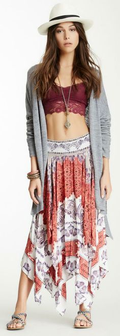 Layer it up, Festival style with a fedora, cardigan, cropped bralette, and flowey skirt