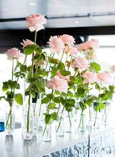 Love the look of this and the different sizes vases - maybe do something like this for our centerpieces, except with rosemary?