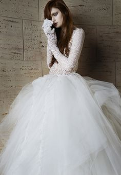 Look 15. Ivory web lace long sleeve blouse. Ivory tulle ball gown skirt with ruched details.