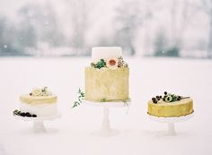 Gold and white wedding cakes: http://www.stylemepretty.com/2014/04/24/enchanted-winter-wedding-inspiration/   Photography: Laura Leslie - http://www.lauralesliephotography.com/