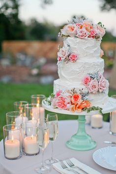 Vintage rustic wedding cake on teal cake stand. We added lots of pillar candles for effect. Events by Evelynn. Photo by Lovisa Photo