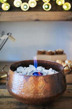 """This clever s'mores """"fire pit"""" is simply canned cooking fuel set in a copper pot filled with stones."""