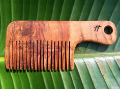 wood comb (made from cherry wood) (functional or decorative). $20.00, via Etsy.