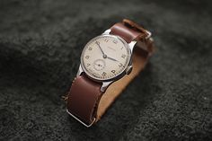 leather nato strap and vintage watch.