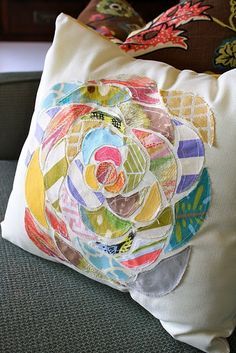 Dying to make this one. Iron on webbing to scraps of fabric and cut out your flower petals, peel & iron onto pillow front, stitch around edges.