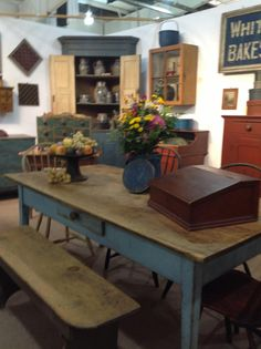 Primitive...old worn blue table & corner cupboard.