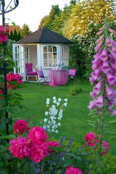 summer house in rose garden