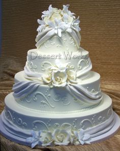 The flowers were hand-made rolled chocolate roses and gumpaste orchids ...