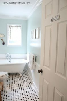 bathroom with blue walls and black and white tile