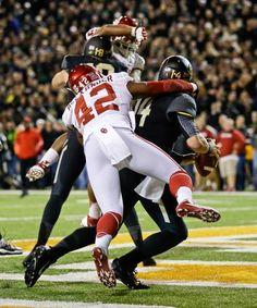 Oklahoma linebacker Dominique Alexander (42) sacks Baylor quarterback Bryce Petty in the end zone for a safety. (Tony Gutierrez/AP)