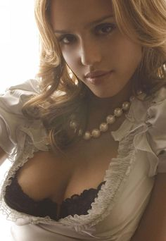 Jessica Alba revealing her cleavage in an open top with black lace bra.