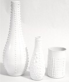Recycle used bottles and cans by making them look like porcelain vases.