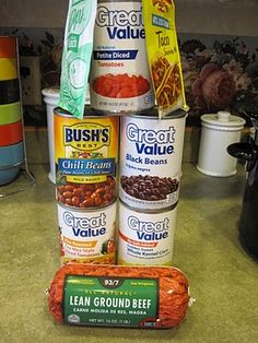 Taco Soup - Brown meat (you can use any ground beef or turkey, put in crock pot with cans of crushed tomatoes, black beans, pinto beans in chili sauce, rotel, and corn.  -add packets of each, ranch powder mix and taco seasonings, and the other seasonings  -stir and simmer on low for 6-8 hours. (or shorter, we just think it gets better over time)