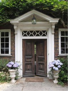 Front Door - love the detail and white frame with dark doors.