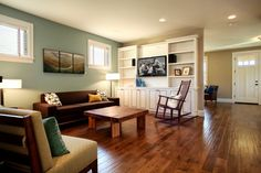 Sherwin Williams halcyon green and balanced beige >> Would LOVE to redo my basement to look like this space! Those floors are beautiful! wall colors, living rooms, floor, color combos, family rooms, paint colors, families, design, accent walls
