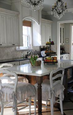 Black granite, tile backsplash, distressed cabinets,