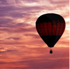 Ride a hot air balloon into the sunset