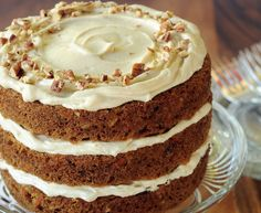 Carrot cake is moist and flavorful with grated #carrots and is frosted with a delicious cream #cheese frosting.