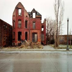 Abandoned Houses in Detroit, Michigan, photography by Kevin Bauman. My son and daughter-in-law found a house in St. Louis that was similar to this and restored it. It's now a wonderful home!