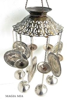 DIY:  Repurposed silver plate becomes a wind chime.  Simply punch a hole in the piece, if needed, and attach a piece of chain to connect the pieces. Inspiration.
