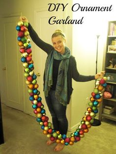 Christmas Decorating DIY Projects: Create a beautiful garland out of colorful ornaments by simply looping ribbon through the ornaments.