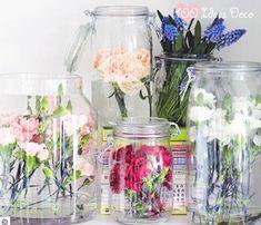 Flowers arranged inside jars/vases