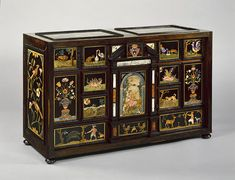Pietre dure cabinet, 1615–20  Court workshop of the grand dukes of Tuscany (Italian, Florence)  Various exotic hardwoods veneered on oak, with ebony moldings; plaques of hardstones and slate; pietre dure work of various hardstones, colored marbles, and rock crystal