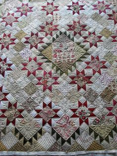 Quilted by Jessica's Quilting Studio  I really like the alternate 4-patches in the muted tones