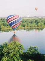 """Soar over the countryside at dawn and watch the world awaken as you silently glide above. Let us provide you with a romantic picnic for you to take along for the ride. Celebrate touching down with an old ballooning tradition of sipping bubbly! Whether you're proposing or just wanting to say """"I love you"""" in the sky, we'll make sure it's unforgettable."""