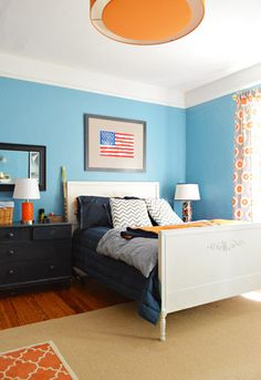 The crisp, clean blue is almost turquoise, but works nicely paired with navy and white in this boy bedroom