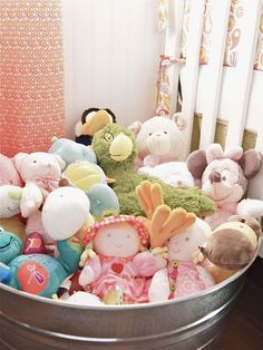 I like this idea for baby toy storage... easy access, and versatile over the years to come.