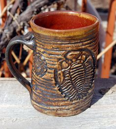 Hand-thrown trilobite mug - Boehme Pottery.