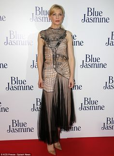 Gothic fail: The Australian star's unflattering sleeveless beige gown ended in an asymmetrical tulle skirt and she accessorised with nude pumps