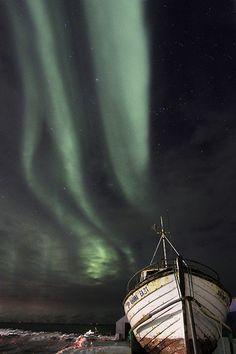 boat and the Northern Lights in Skagafjörður, Iceland