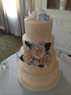 Simple dot wedding cake, Ivory, Blue hydrangeas, ivory roses, love bird topper